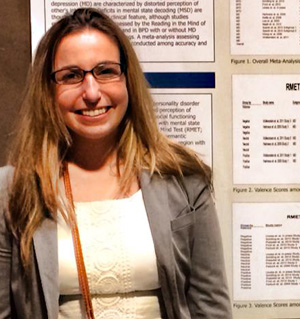 Mara Richman standing by her research posters