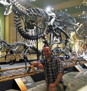 Joel Hutson '02 with Ceratosaurus Carnotaurus at the Dinosaur Discovery Museum of Kenosha