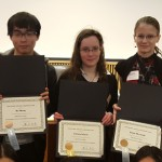 Students display awards from Japanese speaking contest