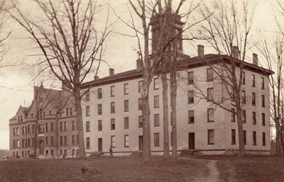 The Men's Dorm before a fire. Bowen Hall is in the background at left