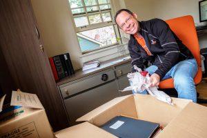 Eric Staab unpacking at the new Kalamazoo College Admission Center