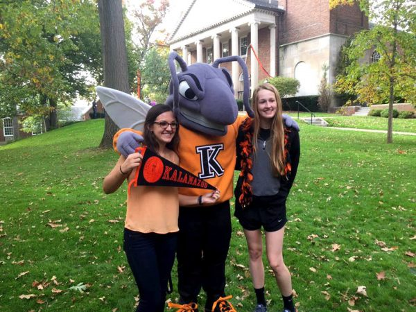 Two students with Buzz the Hornet at Homecoming 2017