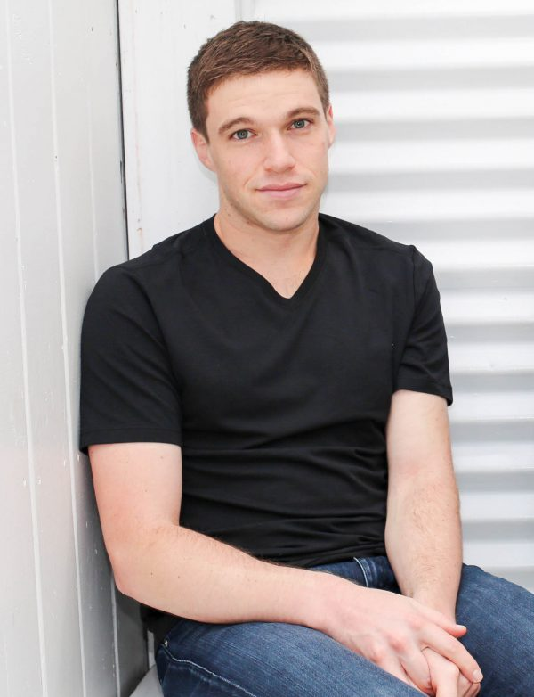 Peter Rothstein, a 30 Under 30 honoree, in a black t-shirt and blue jeans