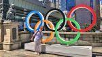 Uyen Trinh standing next to the Olympic rings_fb