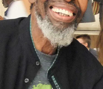 Keorapetse 'Willie' Kgositsile Smiles to the camera