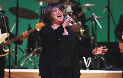 Mavis Staples singing in concert