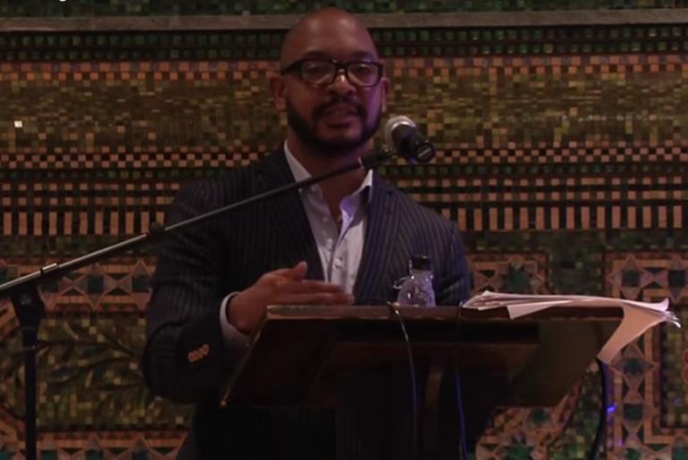 Roderick Ferguson speaking at podium