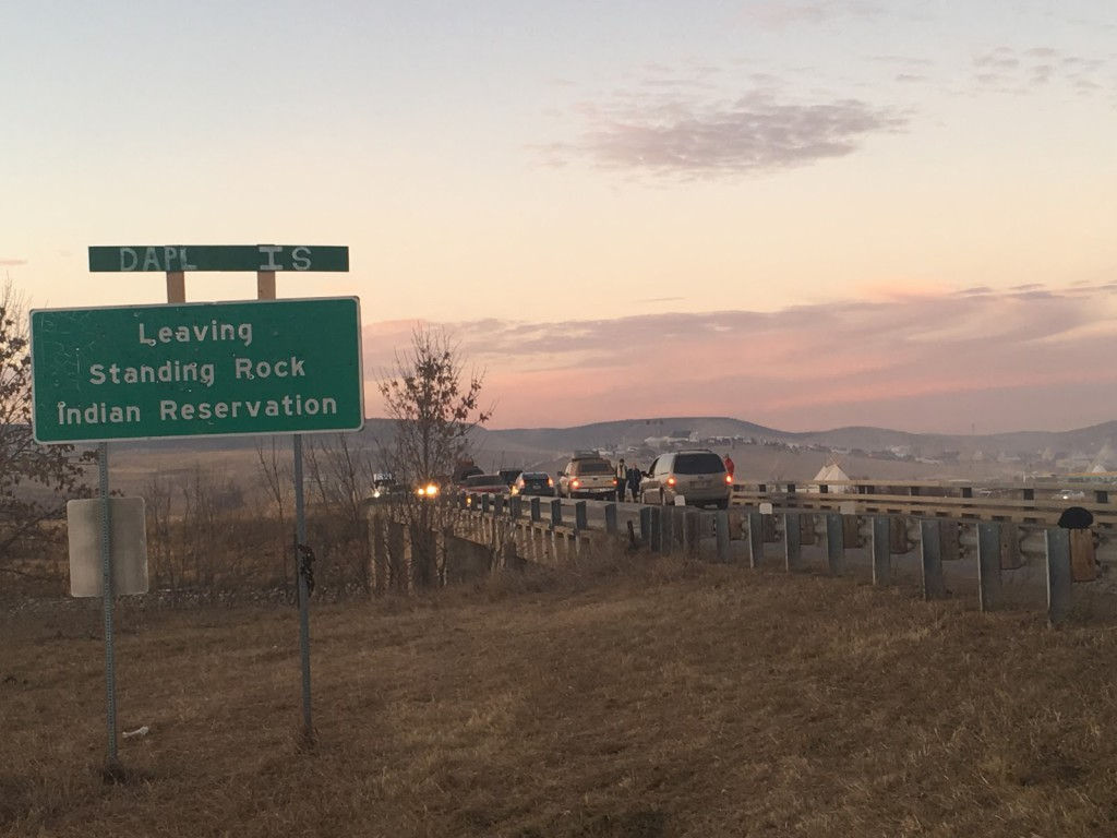 """Street sign with addition to read """"DAPL is Leaving Standing Rock Indian reservation"""""""