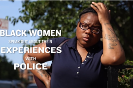 "Black woman holding her hand to her head with text ""Black women speak about their experiences with police"""