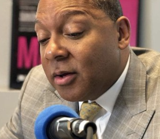Wynton Marsalis speaking into a microphone