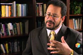 Dr. Michael Eric Dyson in front of a bookshelf